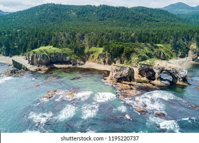 Aerial drone photo of cape Ptichiy (near by cape Velikan), Sakhalin island, Russia (Sahalin). Surrealistic landscape of natural arches created by wind and sea erosion. Pacific Ocean, Sea of Okhotsk.