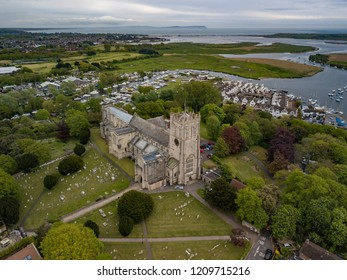 Aerial drone photo of Christchurch Priory with river Stour and mudeford harbour in the background in dorset england