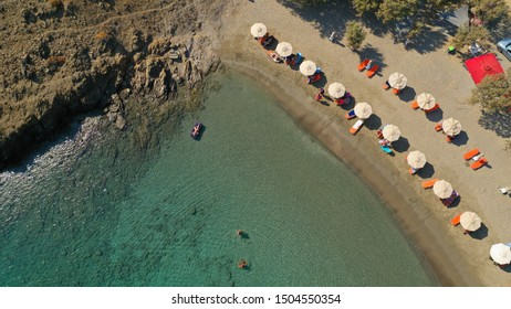 Aerial drone photo of famous calm turquoise sea sandy beaches of Steno next to small chapel of Agios Mamas, Astypalaia island, Dodecanese, Greece