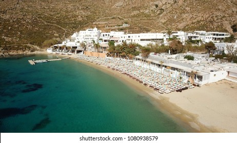 Aerial drone photo of famous clear water beach of Psarou in iconic island of Mykonos, Cyclades, Greece