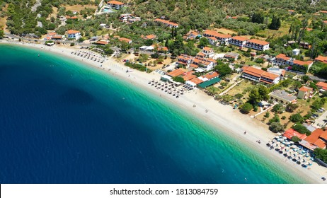 Aerial drone photo of famous crystal clear turquoise beach and bay of Panormos a popular safe sail boat anchorage in island of Skopelos, Sporades, Greece