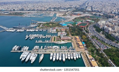 Aerial drone photo of famous Flisvos Marina with mega yachts and sail boats docked, Athens riviera, Attica, Greece