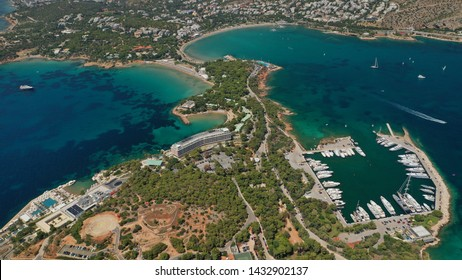 Aerial drone photo of famous luxurious Lemos peninsula in Vouliagemeni area with iconic celebrity sandy beach of Asteras, Athens riviera, Glyfada, Attica, Greece