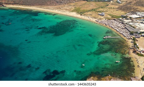 Aerial drone photo of famous organized beach of Panormos in North island of Mykonos, Cyclafes, Greece
