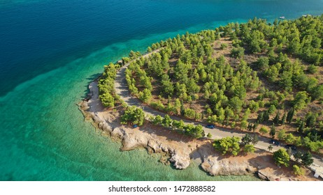 Aerial drone photo of famous seaside area and forest of Kentri in picturesque village and port of Galaxidi, Fokida, Greece