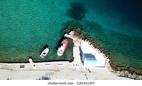 Aerial drone photo from famous small chapel in lake Vouliagmeni in Loutraki with crystal clear waters, Perachora, Greece