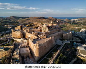 Aerial drone photo - The Gozo Citadel at sunset.  A medieval fortress in the city of Victoria (Rabat).  Island of Gozo, Malta.