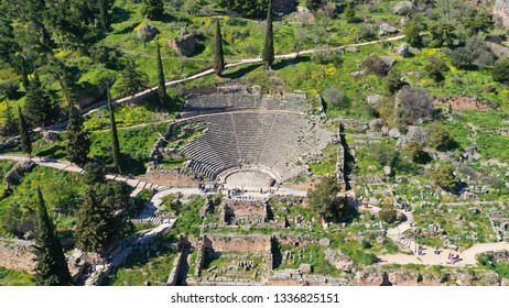 Aerial drone photo of iconic ancient theater in archaeological site of Delphi one of the most important of Ancient times, Voiotia, Greece