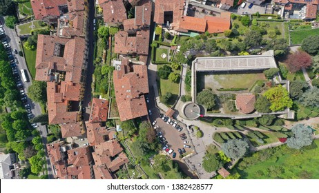 Aerial drone photo of iconic and beautiful old fortified Castle in upper Medieval city of Bergamo, Lombardy, Italy