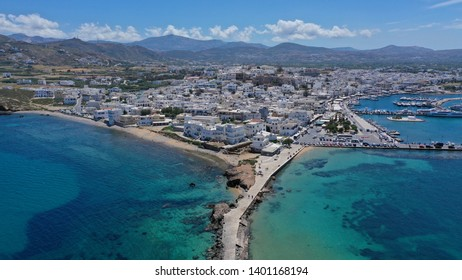 Aerial drone photo of iconic chora, main town of Naxos island with beautiful uphill castle with views to the Aegean deep blue sea, Cyclades, Greece