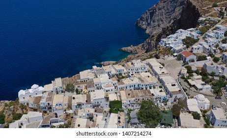 Aerial drone photo of iconic and picturesque main village (chora) of Folegandros island featuring castle and built on top of steep hill overlooking the Aegean blue sea, Cyclades, Greece