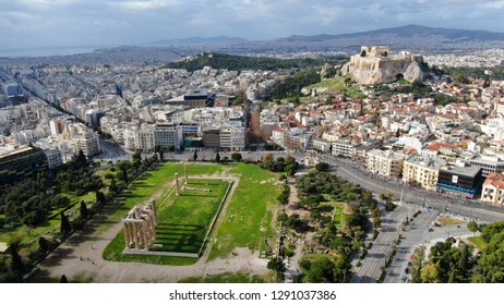 Aerial drone photo of iconic pillars of ancient Temple of Olympian Zeus and Acropolis hill at the background, Athens historic center, Attica, Greece