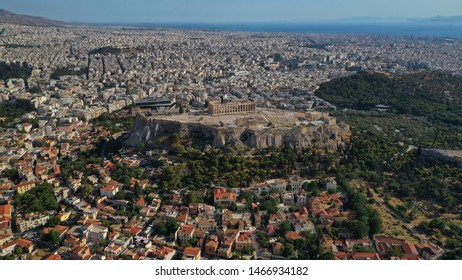 Aerial drone photo of iconic Plaka and Monastiraki districts and iconic Acropolis hill with masterpiece of Western Ancient world the Parthenon, Athens historic centre, Attica, Greece