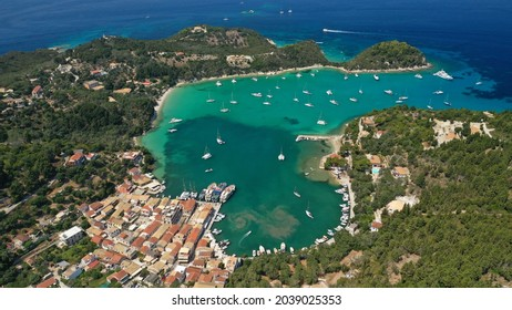 Aerial drone photo of iconic port and fishing village of Lakka or Laka with traditional Ionian architecture a safe anchorage for sail boats and yachts, Paxos island, Ionian, Greece