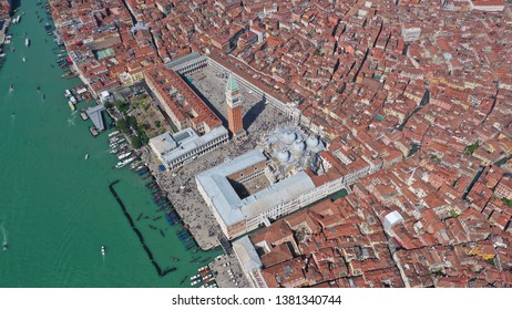 Aerial drone photo of iconic and unique Saint Mark's  square or Piazza San Marco featuring Doge's Palace, Basilica and Campanile, Venice, Italy
