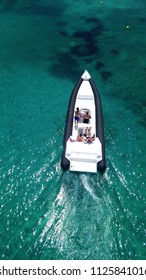 Aerial drone photo of inflatable power boat cruising in high speed in tropical emerald clear water sea