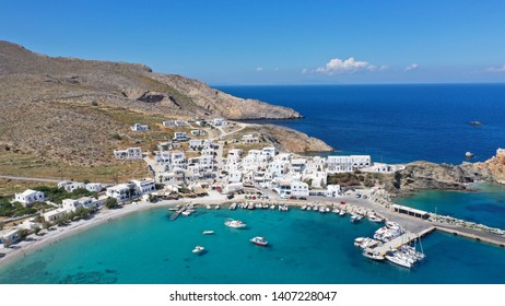 Aerial drone photo of Karavostasis picturesque main port of Folegandros island featuring sandy pebble beach, Cyclades, Greece