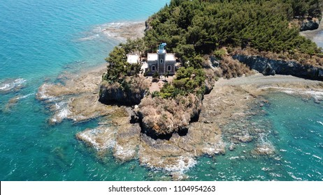 Aerial drone photo of lighthouse in small islet of Halkida with clear water seascape, Evia island, Greece