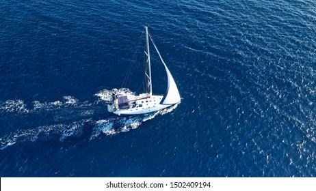 Aerial drone photo of luxury sail boat cruising in the deep blue Aegean sea, Greece