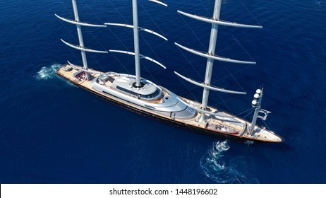Aerial drone photo of massive and iconic Super Yacht Maltese Falcon sail boat cruising in the deep blue sea of Mykonos island, Cyclades, Greece