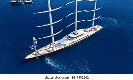 Aerial drone photo of massive - iconic Super Yacht Maltese Falcon sail boat cruising in the deep blue Aegean sea, Greece