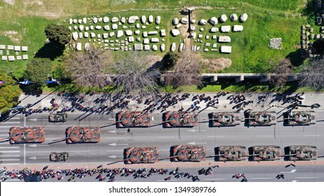 Aerial drone photo of military tanks stoped in archaeological site of Temple of Zeus during anual parade of Greek independence day on March 25, Athens, Attica, Greece