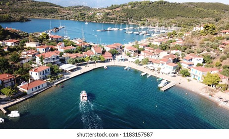 Aerial drone photo of the one and only inhabited island in the Corinthian gulf called Trizonia with natural beauty and small safe port, Greece