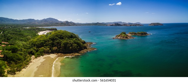 Aerial drone photo of the Pacific Ocean meeting the beaches & rainforest Costa Rica