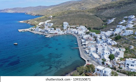 Aerial drone photo of picturesque beautiful fishing village and small harbour of Panormos, Tinos island, Cyclades, Greece