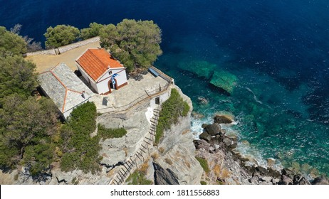 Aerial drone photo of picturesque chapel of Saint John built in famous cliff where Mamma Mia movie was filmed, Skopelos island, Sporades, Greece