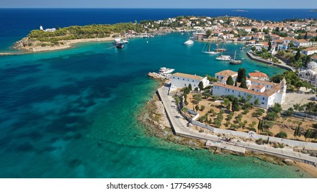 Aerial drone photo of picturesque and historic Agios Nikolaos church in old town of Spetses island, Saronic gulf, Greece