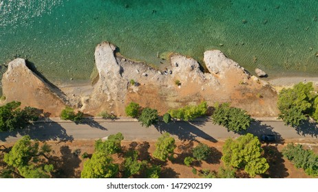 Aerial drone photo of picturesque rocky coves in Kentri area with emerald clear sea, Galaxidi picturesque village, Fokida, Greece
