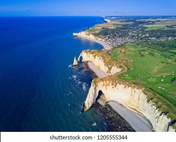 Aerial drone photo of the pointed formation called L'Aiguille or the Needle and Porte d'Aval at Etretat, a commune in the Seine-Maritime department in the Normandy region of north western France