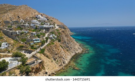 Aerial drone photo of rocky seascape near famous organized beach of Panormos in North island of Mykonos, Cyclafes, Greece