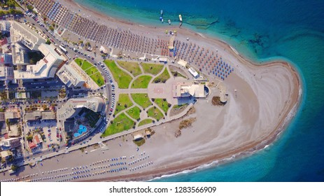 Aerial drone photo of Rodos island town peninsula with luxury resorts and sandy beach with sunbeds and umbrellas, Dodecanese islands, Greece