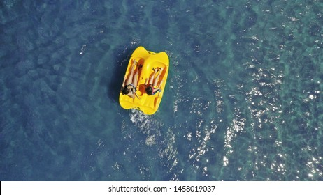 Aerial drone photo of sea bike with couple paddling in tropical exotic turquoise sea