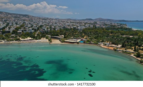 Aerial drone photo of seaside sandy organised beach area of Glyfada with sun beds and umbrellas and emerald clear sea, Athens riviera, Attica, Greece