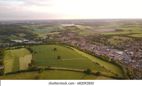 Aerial drone photo of a small town and country side just as the sun has set.