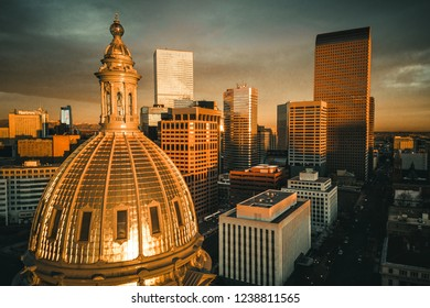 Aerial drone photo - Sunrise over the golden Colorado State Capitol Building. Denver