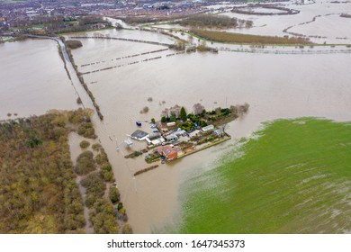 Aerial drone photo of the town of Allerton Bywater near Castleford in Leeds West Yorkshire showing the flooded fields and farm house from the River Aire during a large flood after a storm.