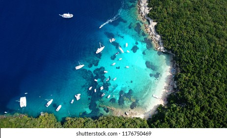 Aerial drone photo of tropical exotic caribbean paradise vegetated island with blue lagoon turquoise sea and sail boats