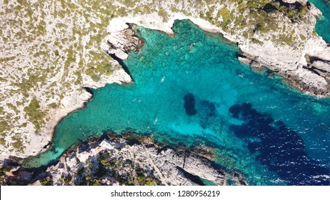 Aerial drone photo of tropical seascape with white rock volcanic caves and turquoise sea