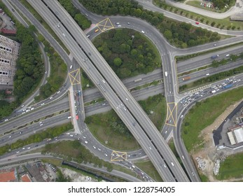 Aerial drone photo of urban elevated toll ring road junction and interchange overpass.