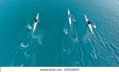 Aerial drone photo of young men competing with sport canoe in tropical port with calm sea