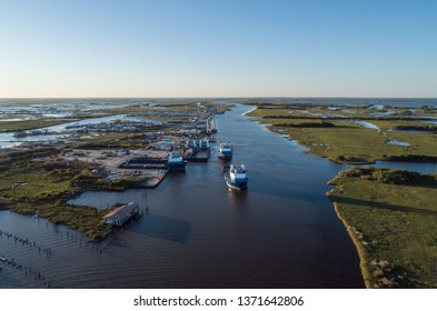 Aerial Drone Photography of ships heading to the gulf of Mexico at sunset.
