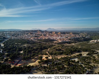 Aerial drone point of view photography surrounding countryside and Quesada district in the municipality of Rojales. Sunny day wide high angle landscape. Province of Alicante, Spain