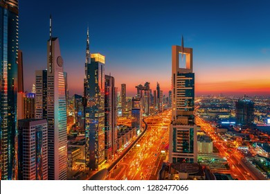 Aerial drone rooftop night view over Dubai city