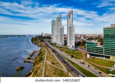 Aerial Drone Scene of Rosario City Skyline and Parana River with  Skyscrapers in Business District.