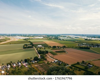 Aerial drone shot of the beautiful flat landscape of the Netherlands.