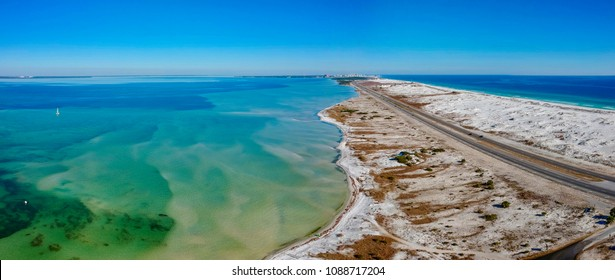 Aerial drone shot of the gulf and the bay. The road between Okaloosa Island and Destin Florida.